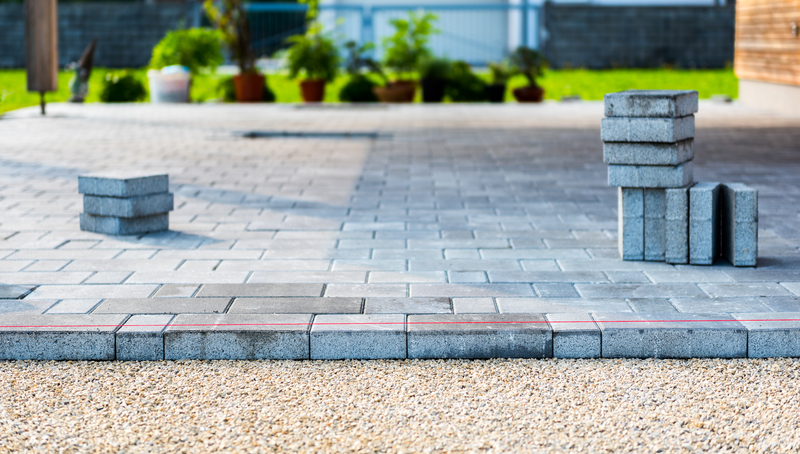 laying gray concrete paving slabs